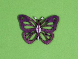 Vyřezávaný motýl barevný